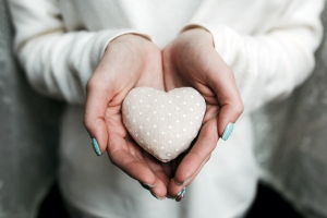 Girl holding a small lovely heart